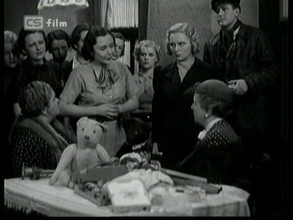Děvče za výkladem (1937)