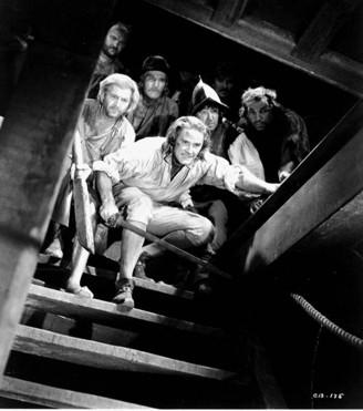 Errol Flynn (26) a Olivia de Havilland (19).