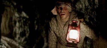 Ve stínu hor (2009)