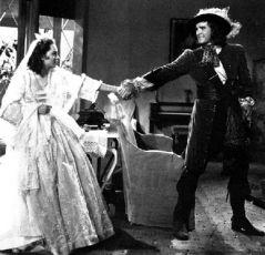 Errol Flynn (26) a Olivia de Havilland (19). Olivia de Havilland Errol Flynn