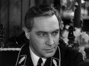 V. Tichonov ako Maxim Isajev / Max Otto von Stirlitz